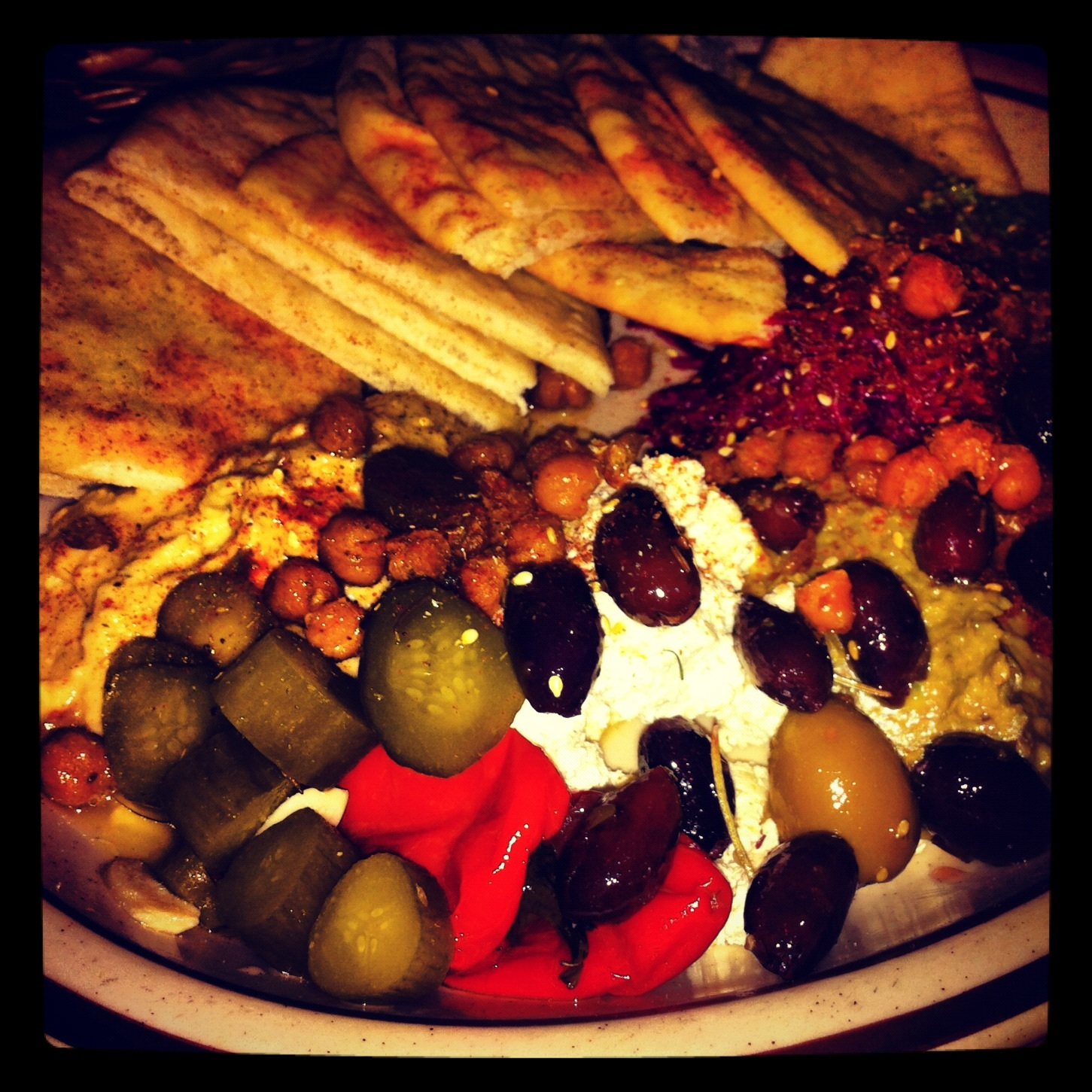 Fun, dynamic dishes like the Mezze Platter, are a perfect counterpart to  the trendy bar scene and live jazz music at The Beehive.